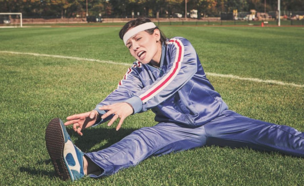 Image of Woman Struggling to Stretch Properly