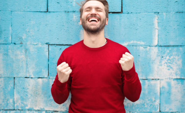 Image of man in red shirt looking excited