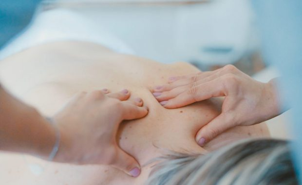 Image of woman getting a back massage in Fort Worth