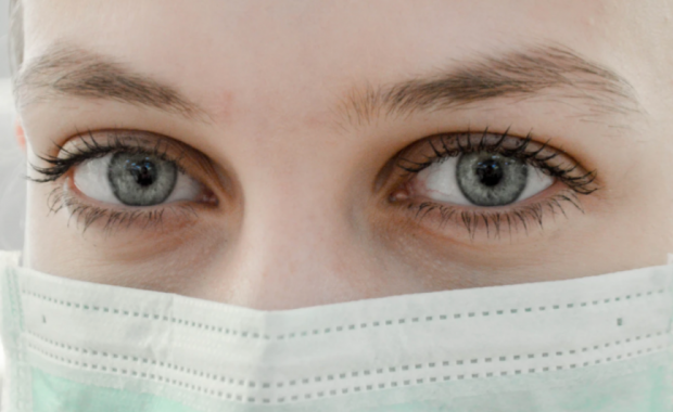 Image of woman wearing a medical mask